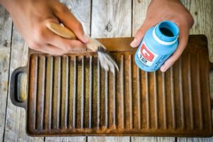 Use a paint brush to apply the Rust Remover to the griddle pan